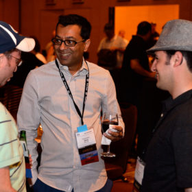 Three Pawn Expo attendees enjoying drinks and conversation at the pawnbroker Mix and Mingle.